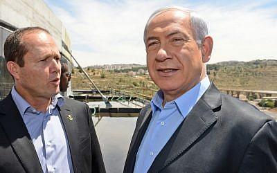 Prime Minister Benjamin Netanyahu (right), and Jerusalem Mayor Nir Barkat tour the new sports arena under construction in Jerusalem, on Thursday, May 15, 2014. (photo credit: Haim Zach/GPO/Flash 90)