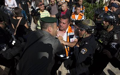 Israeli police in a confrontation with Palestinians at a Nakba Day event, outside the Old City of Jerusalem, on May 15, 2014. (photo credit: Yonatan Sindel/Flash90)