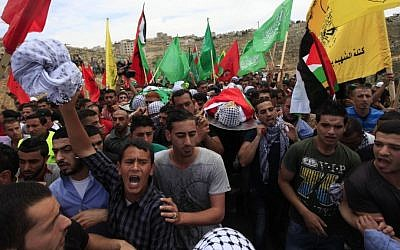 Palestinians mourn the deaths of two Palestinian teens, shot by the IDF, at their joint funeral in the West Bank town of Birzeit, north of Ramallah, on May 16, 2014. (photo credit: Issam Rimawi/Flash90)