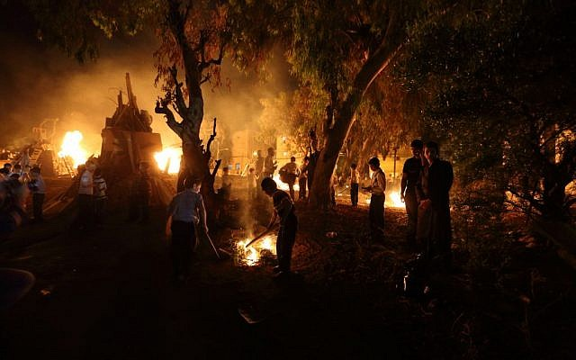 Ultra-Orthodox Jews gather around the bonfire during celebrations of the Jewish holiday of Lag B'Omer in the ultra-Orthodox city of Bnei Brak, outside of Tel Aviv, on May 17, 2014. (photo credit: Yaakov Naumi/Flash90)