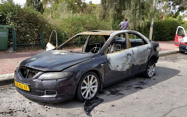 The torched car of Naser Abu Taha. (photo credit: Flash90)