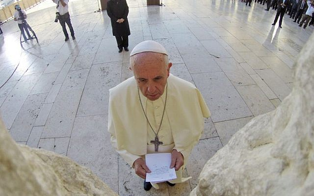 Pope Francis seen praying in front of the Western Wall, Judaism's holiest site, in Jerusalem's Old City, on May 26, 2014. (photo credit: Kobi Gideon/GPO/Flash90)