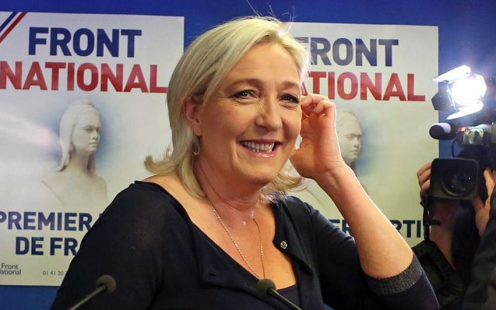 Far right party National Front leader Marine Le Pen poses for photographers before addressing reporters at the party's headquarters in Nanterre, west of Paris, Sunday May 25, 2014.(Photo credit: AP/Remy de la Mauviniere)