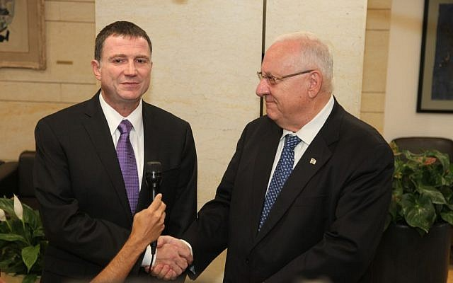 Knesset Speak MK Yuli Edelstein (L) accepts the candidacy for president of Israel from Likud MK Reuven Rivlin (R), May 27, 2013. (photo credit: Knesset Spokesperson)