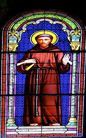 A stained glass picture of St. Francis of Assisi, with a bullet hole through his heart from the 1948 War of Independence, in the St. Louis French Hospital in Jerusalem. (photo credit: Moti Tufeld)
