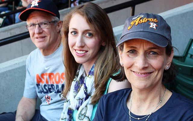 Karen Zeid, right, with husband Ira and daughter Emily at the Astros game against the Orioles in Baltimore on May 11, 2014, has chronicled her son's roller-coaster baseball journey with a journal. (Hillel Kuttler/JTA)