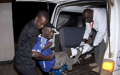 An injured man is carried from an ambulance at Kenyatta National Hospital, Nairobi, Sunday May 4, 2014. (Photo credit: AP/Sayyid Azim)