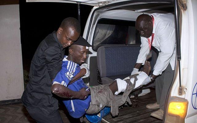 An injured man is carried from an ambulance at Kenyatta National Hospital, Nairobi, Sunday May 4, 2014. (Photo credit: AP/Sayyid Azim)