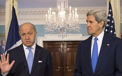 Secretary of State John Kerry listens as French Foreign Minister Laurent Fabius speaks prior to their meeting at the State Department in Washington, Tuesday, May 13, 2014. (photo credit: AP Photo/Molly Riley)
