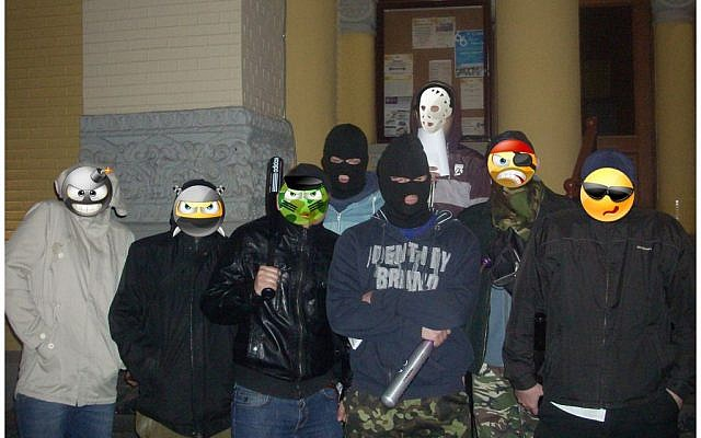Members of Kiev's Jewish rapid-intervention force, some with faces masked digitally by emoji. (photo credit: JTA/Courtesy)