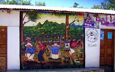 A building displaying indigenous Mayan art in San Juan La Laguna, Guatemala (Chixoy, CC-BY-SA, via wikipedia)