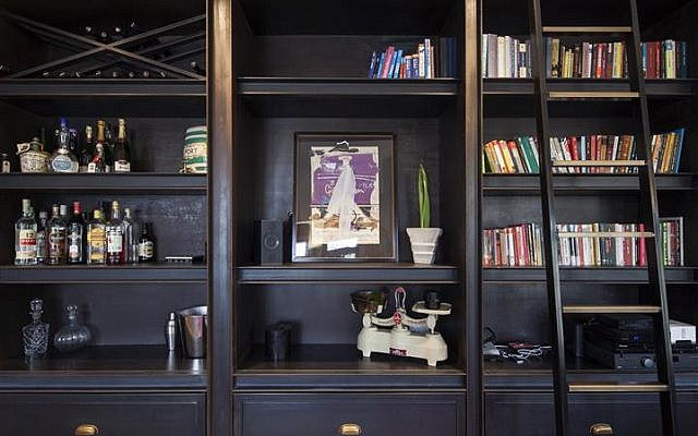 The built-in bookcases are made of iron, an industrial detail meant to remind the dwellers of the building's previous history (Courtesy Tel Aviv municipality)