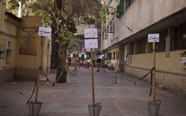 A polling site is nearly empty in the upscale Zamalek district of Cairo, Egypt, Tuesday, May 27, 2014, the second and final day of the presidential election with the country's former military chief Abdel-Fattah el-Sissi poised for an almost certain victory.  (photo credit: AP/Maya Alleruzzo)