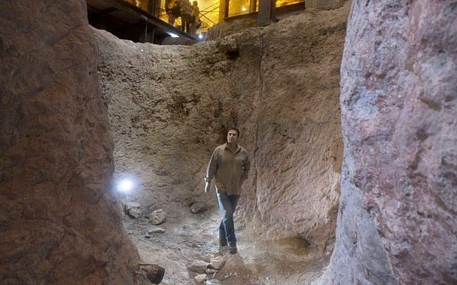 Archaeologist Eli Shukron, who claims to uncovered the citadel captured from the Jebusites by King David, walks in the City of David archaeological site near Jerusalem's Old City on Thursday, May 1, 2014. (AP Photo/Sebastian Scheiner)