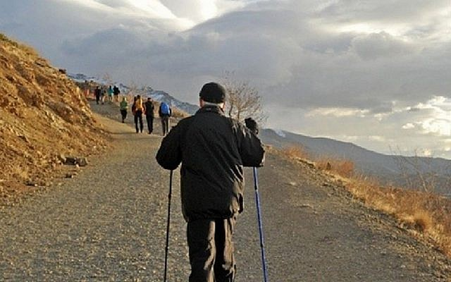 This Dec. 6, 2013 file image posted on his official Instagram account shows Iranian President Hassan Rouhani hiking in the Tochal mountain area north of Tehran, Iran. (photo credit: AP/Office of Hassan Rouhani via Instagram/File)