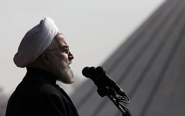 In this Tuesday, February 11, 2014 file photo, Iranian President Hassan Rouhani, delivers a speech during an annual rally commemorating anniversary of the 1979 Islamic revolution, at the Azadi 'Freedom' Square in Tehran, Iran.  (photo credit: AP/Vahid Salemi, File)