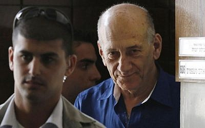 Israel's former Prime Minister Ehud Olmert leaves the Tel Aviv District Court in Israel, on Tuesday, May 13, 2014. (photo credit: AP Photo/Finbarr O'Reilly, Pool)