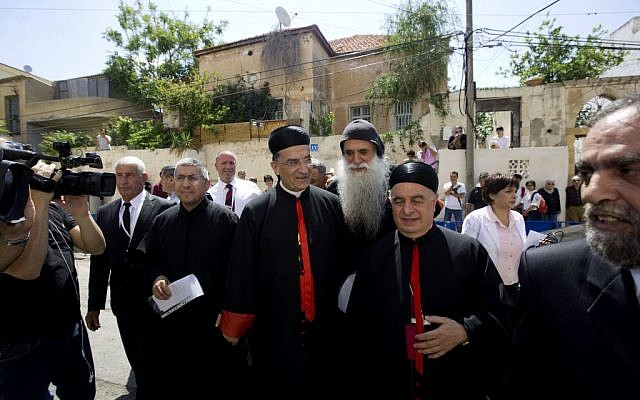 Cardinal Bechara Rai, head of the Maronite Catholic Church, center, arrives to visit a church in Jaffa, a mixed Jewish and Arab neighborhood in Tel Aviv, Israel, Monday, May 26, 2014. (photo credit: AP Photo/Sebastian Scheiner)