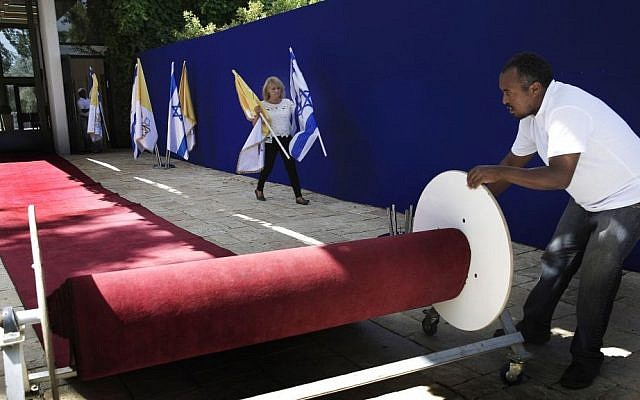Workers at the Israeli president's residence make preparations on Thursday ahead of the Papal visit to Jerusalem. (photo credit: AP/Tsafrir Abayov)