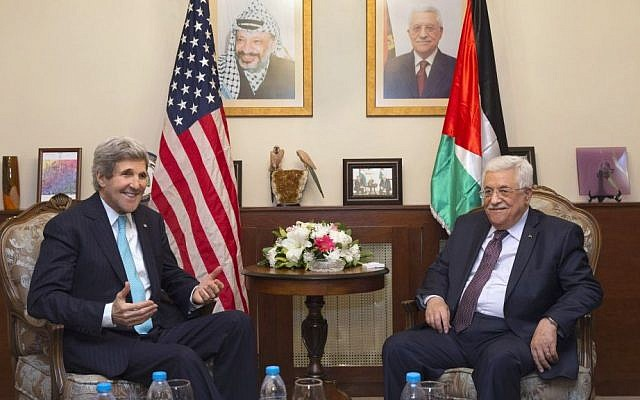 US Secretary of State John Kerry, left, meets with Palestinian Authority President Mahmoud Abbas at the Palestinian Ambassador's Residence in Amman, Jordan, on March 26, 2014. (photo credit: AP/Jacquelyn Martin/Pool/File)