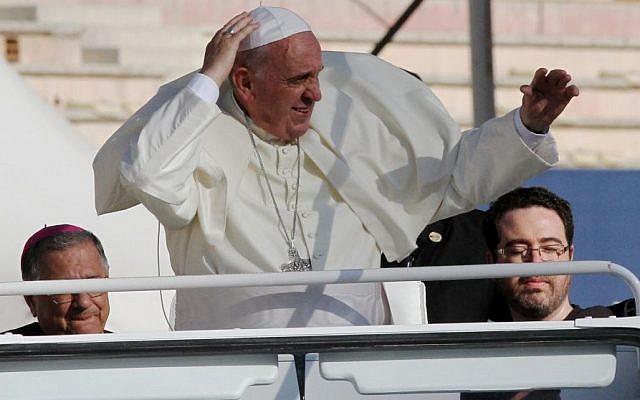 Pope Francis waves at audience members after his arrival at Amman's international stadium in Jordan, Saturday, May 24, 2014. (Photo credit: AP/Raad Adayleh)