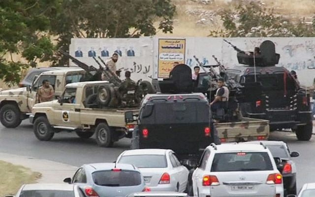 Video image of armed vehicles of the Tripoli joint security forces moving closer to the parliament building after troops of Gen. Khalifa Hifter targeted Islamist lawmakers and officials at the parliament in Tripoli, Libya, on May 18, 2014.  (AP/Libyan national army)