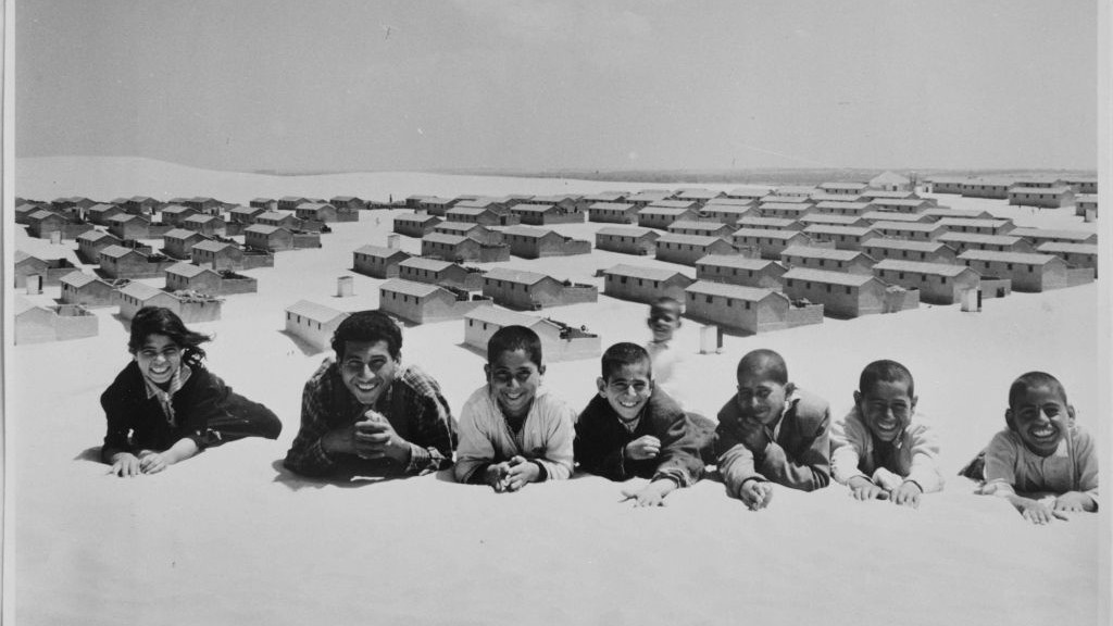 In this 1971 photo from the UNRWA archive, Palestinian refugees pose for a picture in the New Amman refugee camp in Eastern Jordan. (photo credit: AP/G.Nehmeh/UNRWA Photo Archives)