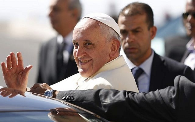 Pope Francis waves upon his arrival at the West Bank town of Bethlehem on Sunday, May 25, 2014. (AP Photo/Mohamad Torokman)