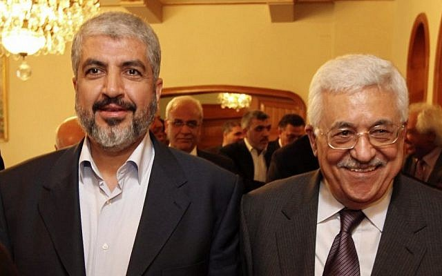 In this file photo provided on Nov. 24, 2011, by the office of Khaled Mashaal, Palestinian Hamas leader Khaled Mashaal, left, and Palestinian Authority President Mahmoud Abbas are seen together during their meeting in Cairo, Egypt. (Photo credit: AP/Office of Khaled Meshaal, File)