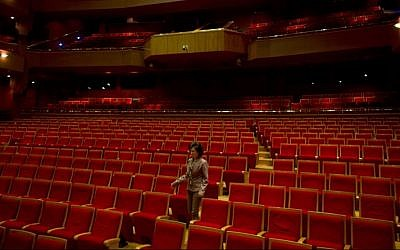 Damascus Opera House director Lama Sallouh walks through the empty theater in Damascus, Syria on Thursday, May 1, 2014. Two art students were killed and five others were wounded when a mortar landed outside the Opera building in April 2014. (AP Photo/Dusan Vranic)