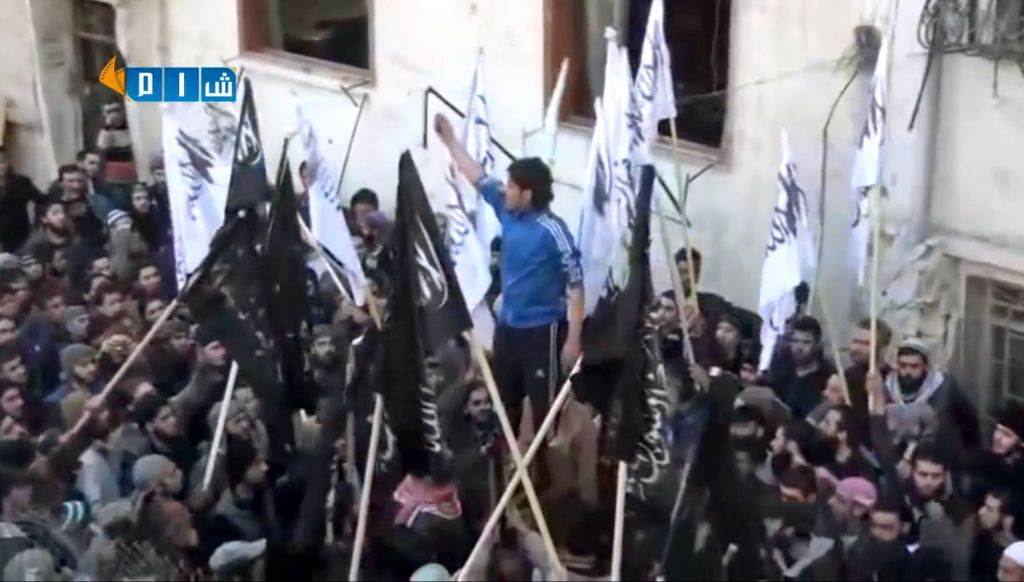 Amateur video image shows revolutionary goalkeeper Abdelbasit Sarout chanting slogans during a demonstration in Homs, Syria,Feb. 13, 2014.  (AP/Shaam News Network via AP video)
