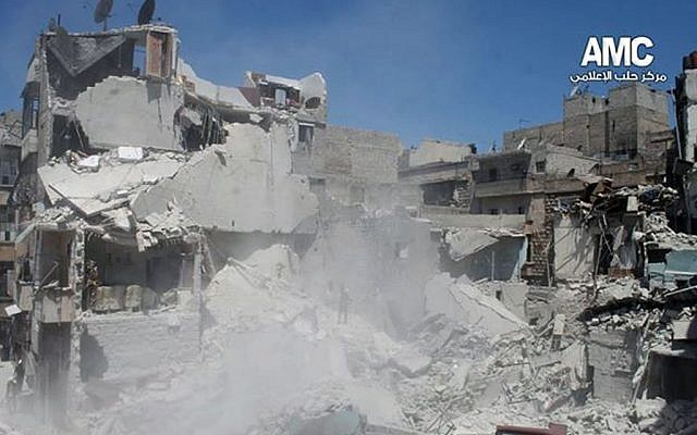 Buildings destroyed from a Syrian government airstrike in Aleppo, Syria, on May 17, 2014.  (photo credit: AP/Aleppo Media CenterAMC)