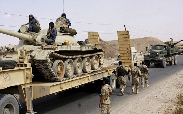 Yemeni troops move near the frontline of fighting with al-Qaeda militants in the province of Shabwa, Yemen, Tuesday, May 6, 2014. (photo credit: AP/Yemen Defense Ministry)