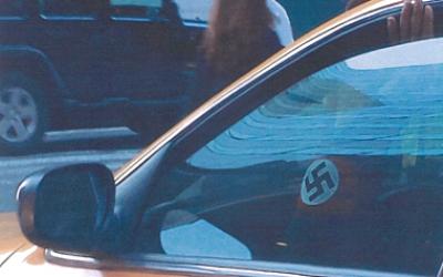 Gabriel Diaz's swastika armband is seen through the window of his cab (photo credit: ADL/JTA)