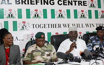 Nigerian officials attend a press conference on the abducted school girls in Abuja, Nigeria, Monday, May 12, 2014 (photo credit: AP/Sunday Alamba)
