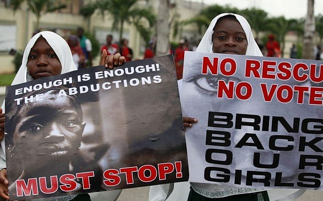 Muslim girls attend a demonstration calling on the government to rescue 276 girls who were kidnapped from a government secondary school, in Lagos, Nigeria, Monday, May 5, 2014. (photo credit: AP/Sunday Alamba)
