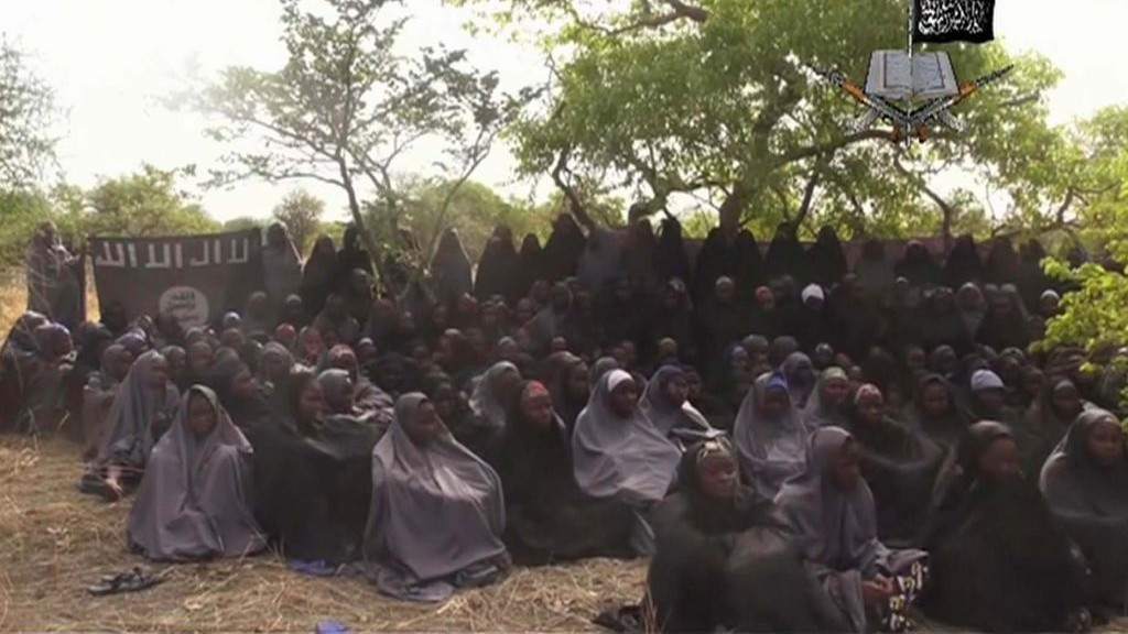 This photo taken from video released by Nigeria's Boko Haram terrorist network on Monday May 12, 2014 shows the alleged missing girls abducted from the northeastern town of Chibok. photo credit: AP)