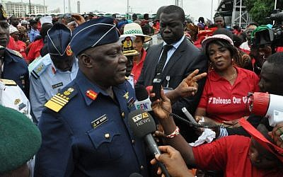 Nigeria's chief of defense staff Air Marshal Alex S. Badeh, centre, speaks during a demonstration calling on the government to rescue the kidnapped girls of the government secondary school in Chibok, in Abuja, Nigeria, Monday, May 26, 2014. (Photo credit: AP/Gbenga Olamikan)