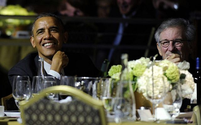 President Barack Obama, left, sits next to movie director Steven Spielberg, right, during the USC Shoah Foundation's 20th anniversary Ambassadors for Humanity gala in Los Angeles, Thursday, May 8, 2014.  (photo credit: AP/Susan Walsh)