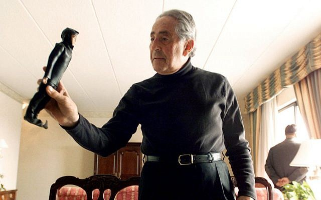 G.I. Joe creator Don Levine holds up his original scuba diver G.I. Joe as other original prototypes lie on top of a table in Providence, R.I. in 2003. (AP Photo/Victoria Arocho, File)