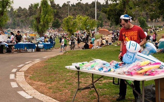 A vendor displays Independence Day paraphernalia for sale at Sacher Park, Jerusalem, Tuesday, May 6, 2014. (photo credit: Yifa Yaakov/The Times of Israel)