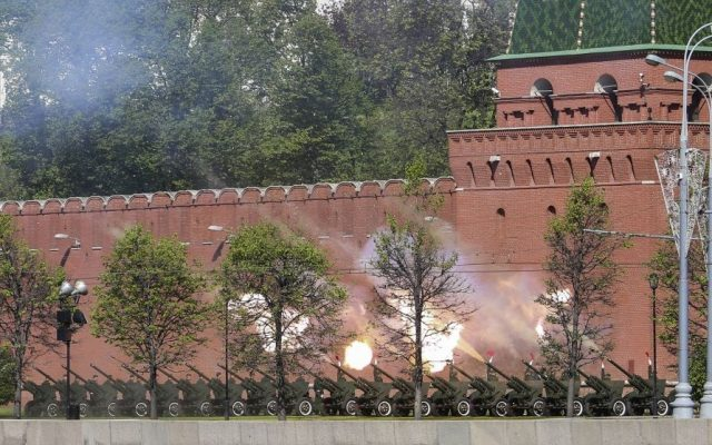 Russian cannons at the Kremlin wall are fired during a Victory Day parade in Red Square, Russia, Friday, May 9, 2014. Russia marked the Victory Day on May 9 holding a military parade in Red Square in Moscow. (Photo credit: AP/Denis Tyrin)