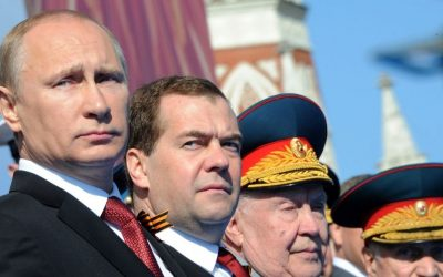 Russian President Vladimir Putin, left, and Prime Minister Dmitry Medvedev attend a Victory Day parade at Red Square in Moscow, Russia, on Friday, May 9, 2014. (photo credit: AP/RIA-Novosti/Mikhail Klimentyev/Presidential Press Service)