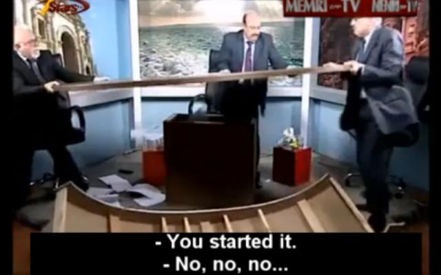 The brawling Jordanian commentators (MEMRI screenshot)