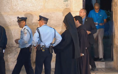 Police and priests outside the Church of the Holy Sepulchre in the Old City of Jerusalem. (screen capture: GPO)