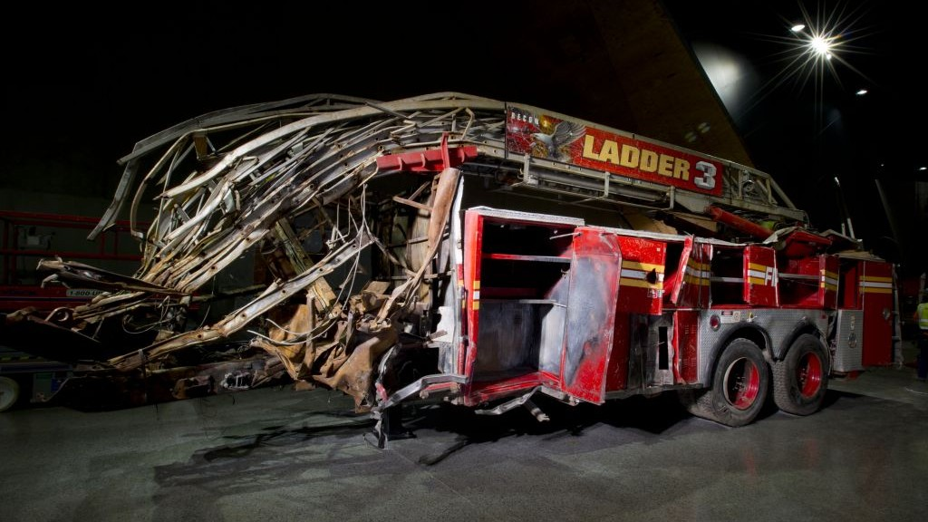 In this May 5, 2014 photo released by the National September 11 Memorial Museum, a firetruck, damaged in the attacks of September 11, 2001, is on display at the museum. (photo credit: AP/National September 11 Memorial Museum/Jin Lee)