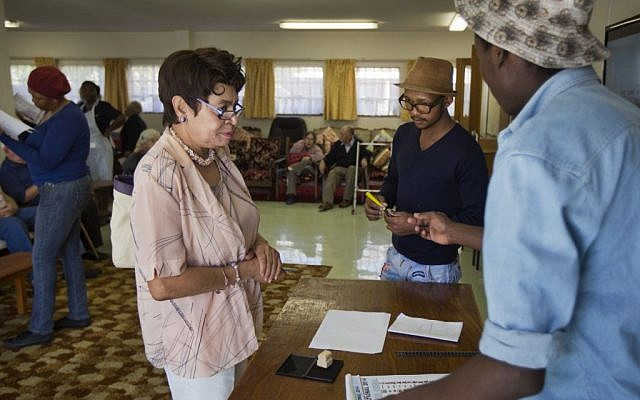 Election workers prepare to give ballot papers to elderly and disabled South African voters to cast their ballots during early voting for special groups at the Nazareth House old-age home in Johannesburg, South Africa Monday, May 5, 2014. South Africa goes to the polls on Wednesday, May 7, 2014 in elections that are likely to see the ruling African National Congress (ANC) party return to power with a smaller majority due to voters disaffected by corruption in government and economic inequality. (photo credit: AP/Ben Curtis)