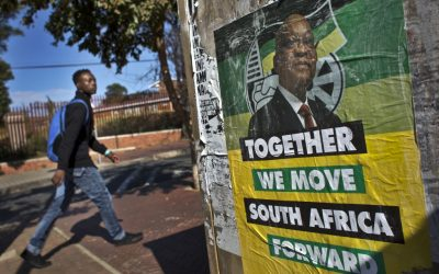 A man walks past an election poster of Jacob Zuma's African National Congress (ANC) party in the Soweto township of Johannesburg, South Africa, on Friday, May 9, 2014. (AP/Ben Curtis)