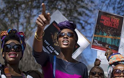South Africans protest in solidarity against the abduction three weeks ago of hundreds of schoolgirls in Nigeria by the Muslim extremist group Boko Haram and what protesters said was the failure of the Nigerian government and international community to rescue them, during a march to the Nigerian Consulate in Johannesburg, South Africa, on  Thursday, May 8, 2014. (photo credit: AP Photo/Ben Curtis)