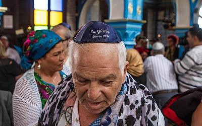 A French Jew, Bebert Zouili, attends the annual pilgrimage in Djerba, Tunisia, in the Ghriba synagogue, the oldest Jewish monument built in Africa more than 2,500 years ago, Friday April 26, 2013. (AP Photo/Aimen Zine)